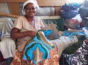 Nwabisa weaving in her home in Khayelitsha